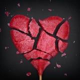 Broken red heart shaped lollipop Stock Images