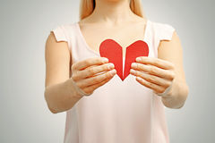Broken red heart in woman hands. Concept of relationship, divorce, pain Royalty Free Stock Images