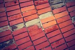 Broken red tiles on old cement floor Stock Photos