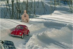 Broken red toy car on a winter road stock images