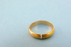Broken ring. Closeup of a gold wedding ring with a crack in it ( divorce concept Stock Images