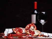 Broken ripe pomegranate and wine Stock Photo