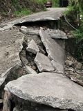 Broken Road. A narrow road destroyed by an earthquake or landslide Royalty Free Stock Images