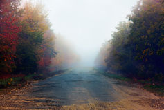 Broken road in fog Royalty Free Stock Image