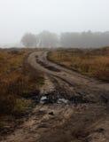 Broken road in fog Stock Photo