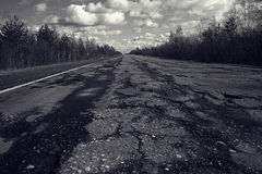 Broken road with holes Royalty Free Stock Images