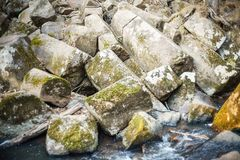 Broken rock on the bank of the stream. Natural stones. royalty free stock image