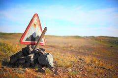 Broken rough road sign Royalty Free Stock Photos