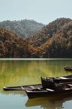 Broken Row Boats in a Mountain Lake Stock Photography