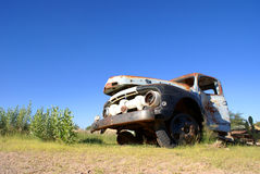 Broken Rusted Truck. Old Ford truck, broken down and rusted. This photo was taken in South Africa, with the clear blue sky in the background Stock Photography