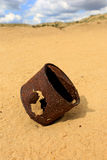 Broken rusty can on sand Stock Photos