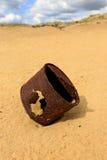 Broken rusty can on sand Stock Photos