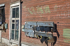 The broken rusty mailboxes on the wall of old wooden house. Irkutsk streets, Russia Royalty Free Stock Photo