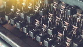 Broken rusty old metal typewriter keys, outdated technology. Background stock photo