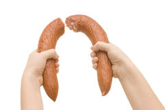 Broken sausage in a hand stock photography