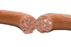 The broken sausage isolated Stock Images
