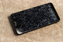 Broken Screen Cellphone, Mobile Phone. The broken screen cellphone on the floor royalty free stock image