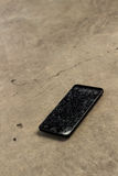 Broken Screen Cellphone, Mobile Phone. The broken screen cellphone on the floor stock photos