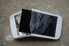 Broken screen cellphone. Broken screen white cellphone stock photos