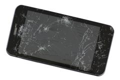 A broken screen of mass production standard black phone. Ga. Dget was wiped from a pneumatic gun. Isolated studio shot. Mass production royalty free stock photos