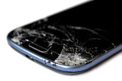 Broken screen of a mobile phone. Isolated on white background royalty free stock photo