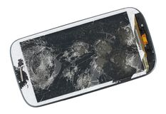 A broken screen of modern phone. This device was wiped from a p. Neumatic gun. Isolated with patch studio shot. Mass production royalty free stock images
