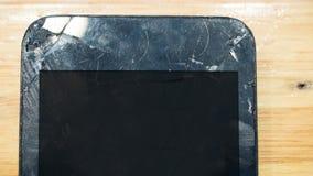 Broken screen phone on wood table. Smart phone stock image