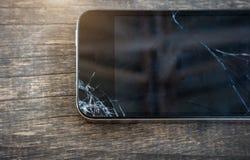 Broken screen of smart phone. Broken screen of black smart phone stock photo