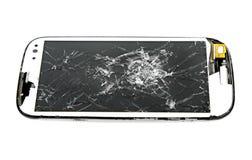 Broken screen smart phone on white background royalty free stock photo