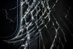 The broken screen of the smartphone close up, you can see the cracks of the glass and shards.  royalty free stock photo