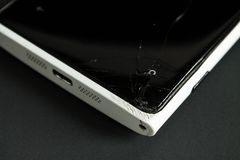 Broken screen smartphone with a cracked screen closeup stock images