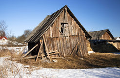 The broken shed. An old wooden shed which started to fall sideways. Belarus Stock Image