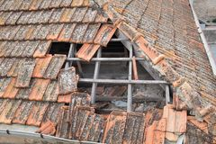 Broken shingles roof. Of abadonned house royalty free stock images