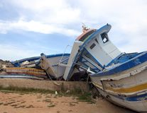 Broken shipwrecks after the disembarkation of refugees. Old broken ancient shipwrecks after the disembarkation of refugees Royalty Free Stock Photography