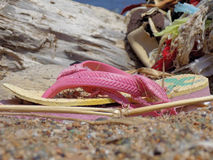 Broken shoes is lying on the sand stock photo