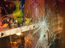 Broken shop window. With color background royalty free stock photography