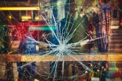 Broken shop window. With color background royalty free stock photos