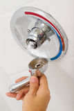 Broken Shower faucet. Cold and hot water in the bathroom Royalty Free Stock Photo