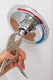 Broken Shower faucet. Fix of broken shower faucet cold and hot water in the bathroom Royalty Free Stock Photography