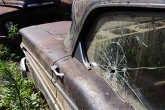 Broken side window in an old car Stock Photo
