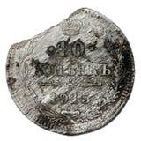 Broken silver coin Royalty Free Stock Photo