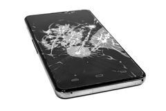 Broken smart phone. Smart phone with a broken screen on an white background royalty free stock photos