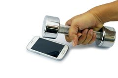 Broken smart phone smashed by dumbbell. Royalty Free Stock Images