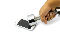 Broken smart phone smashed by dumbbell. Broken smart phone smashed by dumbbell for emotion concept royalty free stock photo