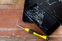 Broken smart phone and tablet on cracked touch screen. Process of mobile phone repair repairing smashed smartphone display fix cellphone cellular disassembled stock photo