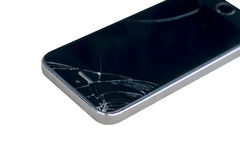 Broken smart phone on white background Royalty Free Stock Photo