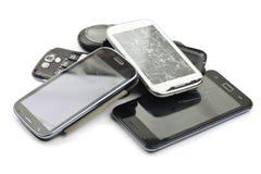 Broken smart phones. Pile of broken smart phones royalty free stock photography