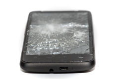 Broken Mobile Phone. Front on shot of a modern smartphone with a shattered screen royalty free stock photography