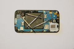 Broken smartphone disassembled Stock Image