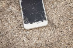 Broken smartphone fallen on a concrete floor Royalty Free Stock Photography